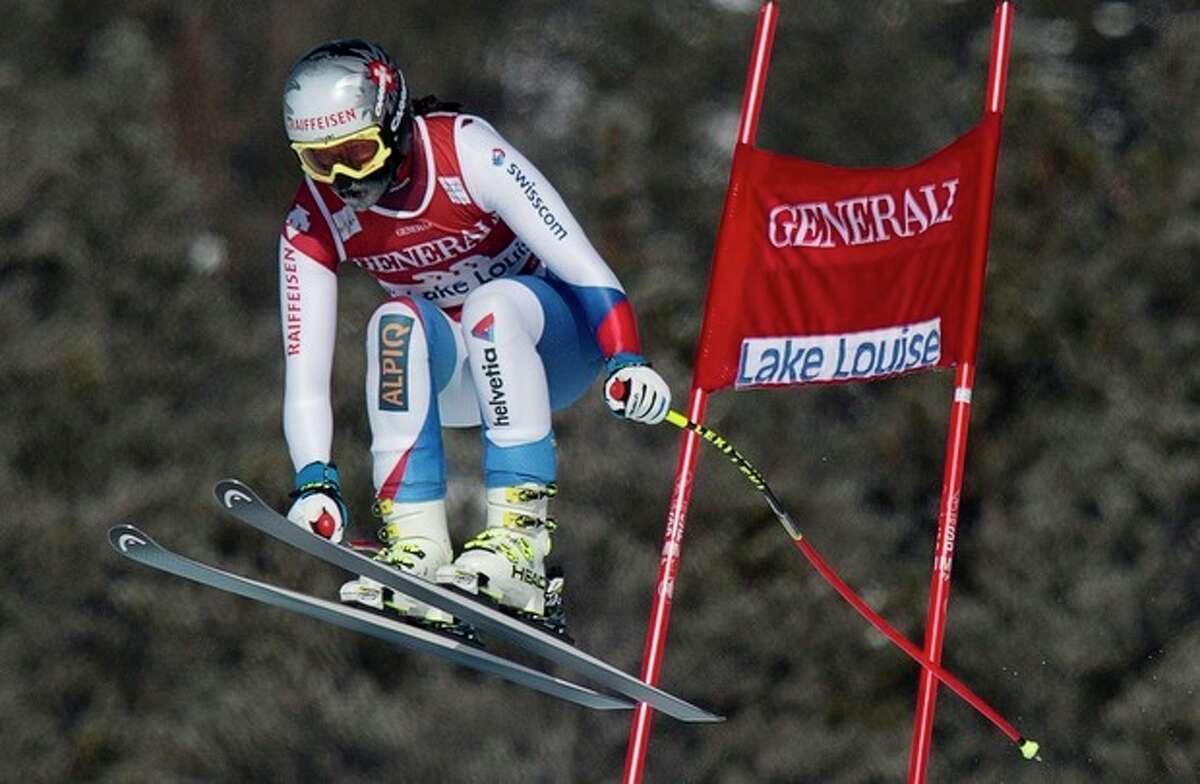 Marianne Kaufmann-Abderhalden, of Switzerland, competes during the women's downhill race at Lake Louise, Alberta, Friday, Dec. 6, 2013. (AP Photo/The Canadian Press, Jonathan Hayward)