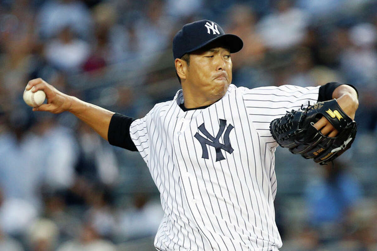 FILE - In this Sept. 3, 2013, file photo, New York Yankees starting pitcher Hiroki Kuroda, of Japan, throws during a baseball game against the Chicago White Sox in New York. Yankees managing general partner Hal Steinbrenner said Friday, Dec. 6, Kuroda is returning for a third season. (AP Photo/John Minchillo, File)