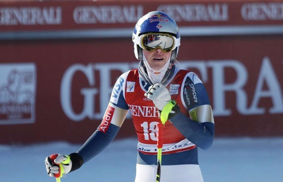 Lindsey Vonn, of the United States, reacts in the finish area following her run at the women's World Cup downhill ski race in Lake Louise, Alberta, Friday, Dec. 6, 2013. (AP Photo/The Canadian Press, Jeff McIntosh)