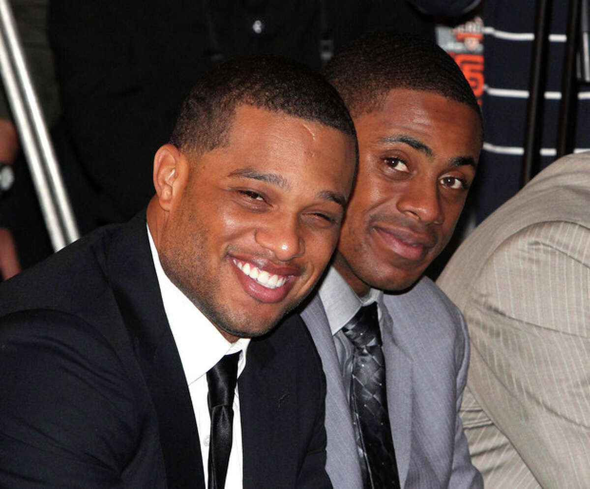 FILE - In this Oct. 30, 2011 file photo, Robinson Cano of the New York Yankees, left, and teammate Curtis Granderson smile during a press conference for a baseball series in Taipei, Taiwan. The Seattle Mariners say that cannot confirm any details of a potential deal with free agent Cano. The team said Friday morning, Dec. 6, 2013, they will announce if an agreement is