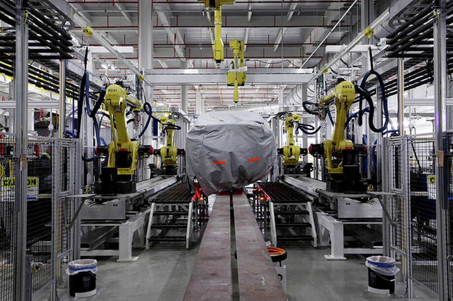 AP Photo / Paul Sancya, FileIn this Tuesday, July 16, 2013, file photo, a covered vehicle sits in part of the new paint shop at Chrysler's Sterling Heights Assembly Plant in Sterling Heights, Mich. Analyst forecast that third-quarter growth will be revised to a 3.1 percent annual rate, faster than the initial estimate of 2.8 percent. / AP
