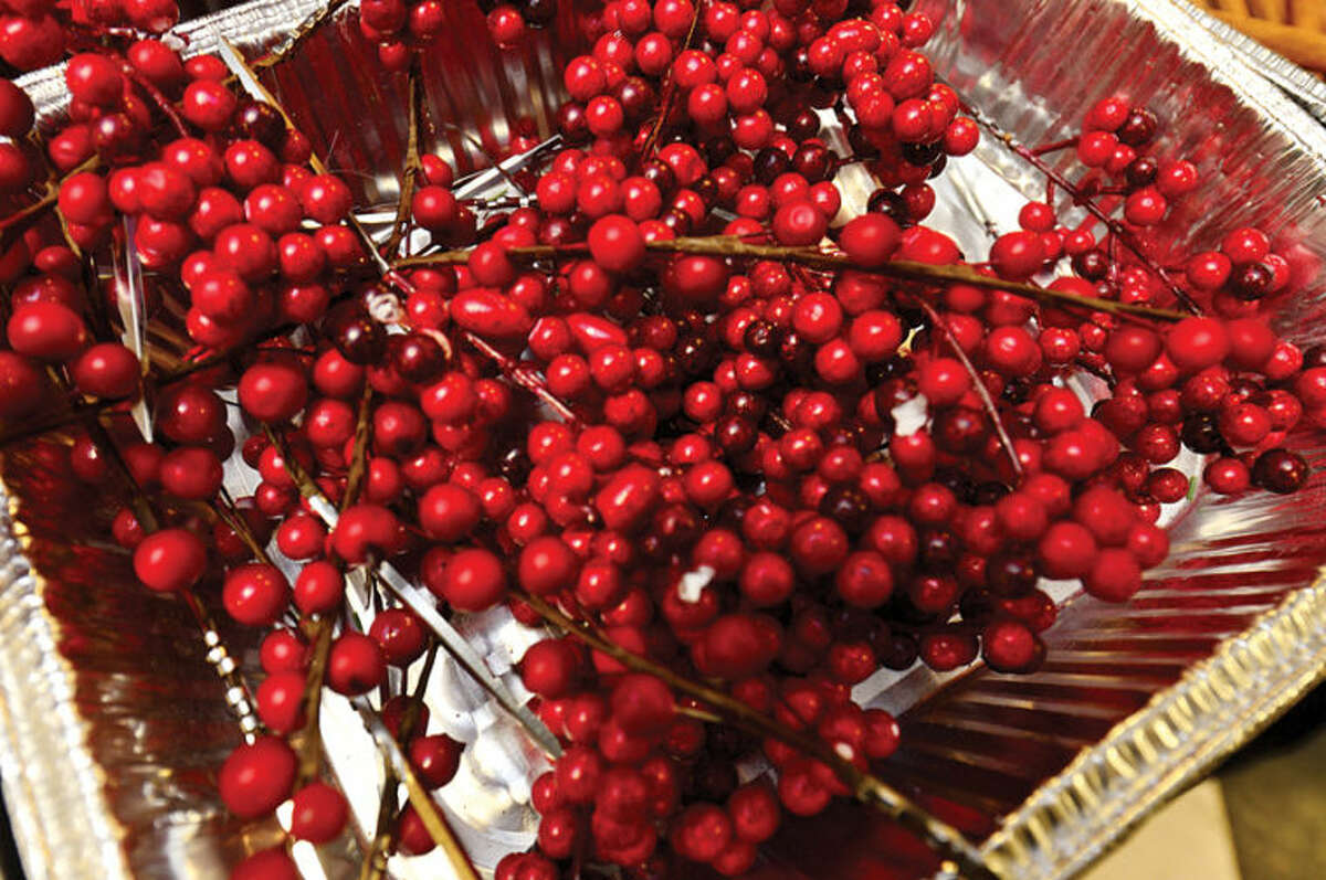Hour photo / Erik Trautmann Rowayton Gardeners Club members create one-of-a-kind wreaths, boxwoods trees and festive table arrangements for their annual christmas fair this Saturday.