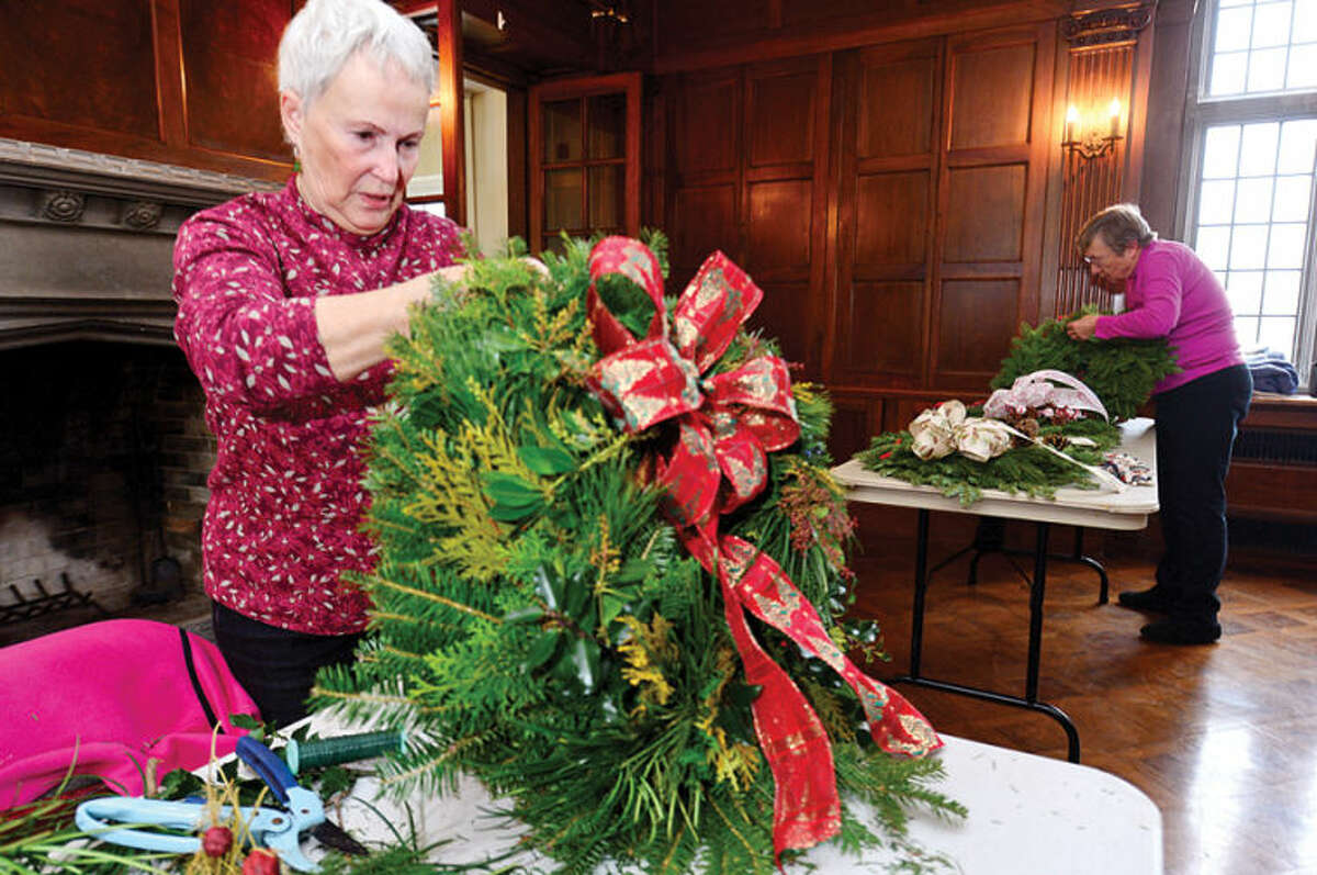 Hour photo / Erik Trautmann Norwalk Garden Club members including Jeanne Brown make wreaths at Gallaher Mansion in advance of their annual craft fair Saturday at Cranbury Chapel.