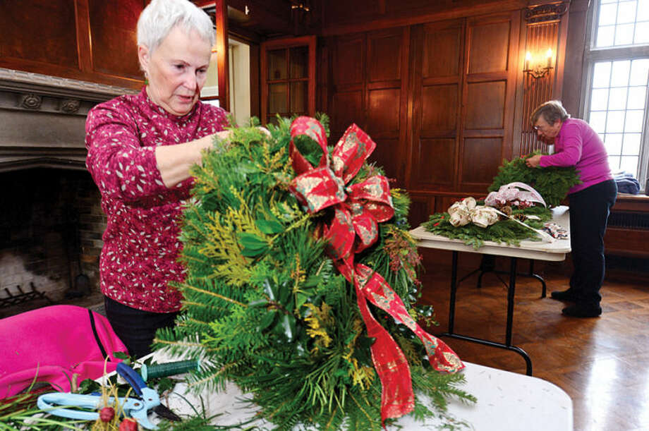 Hour photo / Erik Trautmann Norwalk Garden Club members including Jeanne Brown make wreaths at Gallaher Mansion in advance of their annual craft fair Saturday at Cranbury Chapel.