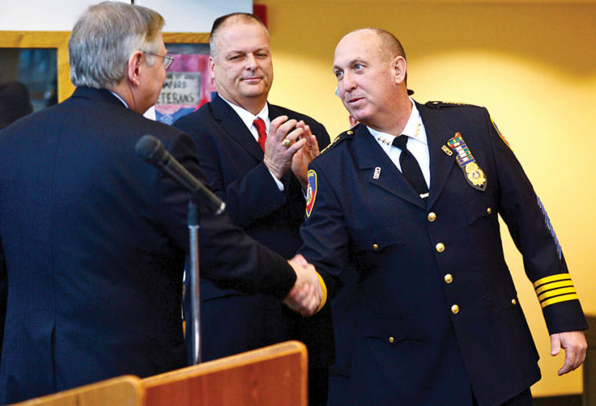 Mayor David Martin appoints several public safety officials Thursday morning including the reappointments of Police Chief Jon Fontineau, right, and Director of Public Safety, Health and Welfare Ted Jankowski at the Stamford Government Center.