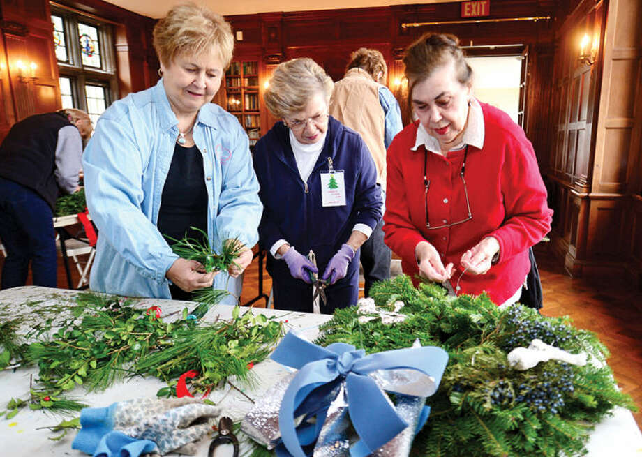 Hour photo / Erik Trautmann Norwalk Garden Club members Betty Downing Janet Valus and Carolw Schor make wreaths at Gallaher Mansion in advance of their annual craft fair Saturday at Cranbury Chapel.