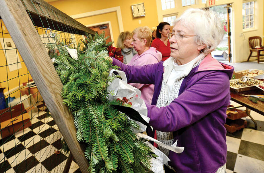 Hour photo / Erik Trautmann Rowayton Gardeners Club members including Jessica Sinha create one-of-a-kind wreaths, boxwoods trees and festive table arrangements for their annual christmas fair this Saturday.