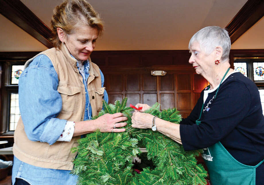 Hour photo / Erik Trautmann Norwalk Garden Club including Jan Broome and Marian Ainsworth make wreaths at Gallaher Mansion in advance of their annual craft fair Saturday at Cranbury Chapel.