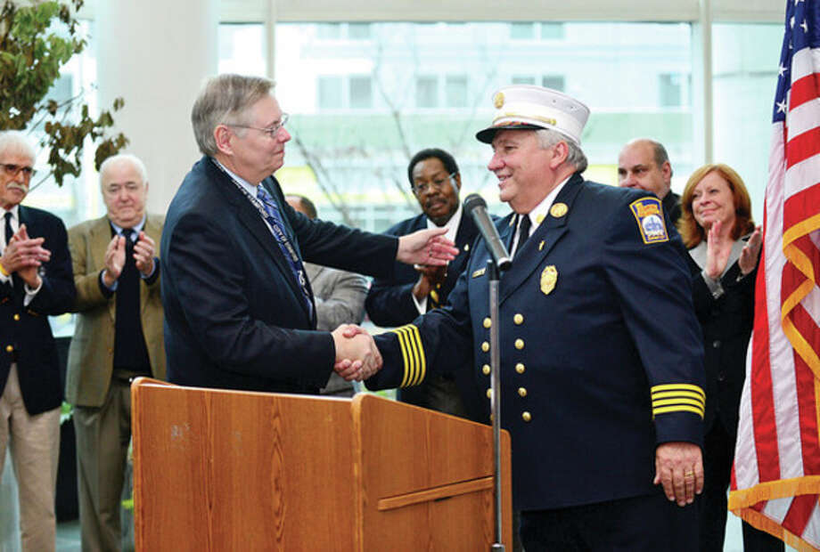 Mayor David Martin appoints several public safety officials including new fire Chief Peter Brown. / (C)2013, The Hour Newspapers, all rights reserved
