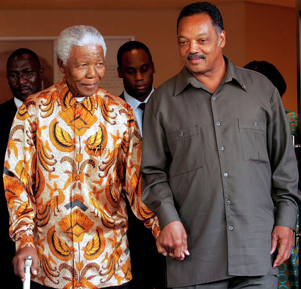 FILE - In this Oct. 26, 2005 file photo, former South African President Nelson Mandela, left, walks with the Rev. Jesse Jackson after their meeting in Johannesburg, South Africa. South Africa's president Jacob Zuma says, Thursday, Dec. 5, 2013, that Mandela has died. He was 95. (AP Photo/Themba Hadebe, File)