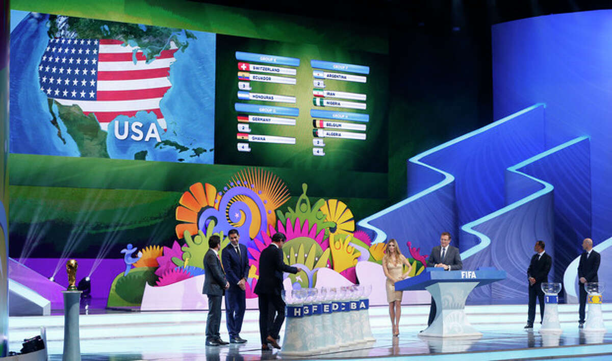 The group of the United States is drawn during the draw ceremony for the 2014 soccer World Cup in Costa do Sauipe near Salvador, Brazil, Friday, Dec. 6, 2013. (AP Photo/Victor R. Caivano)
