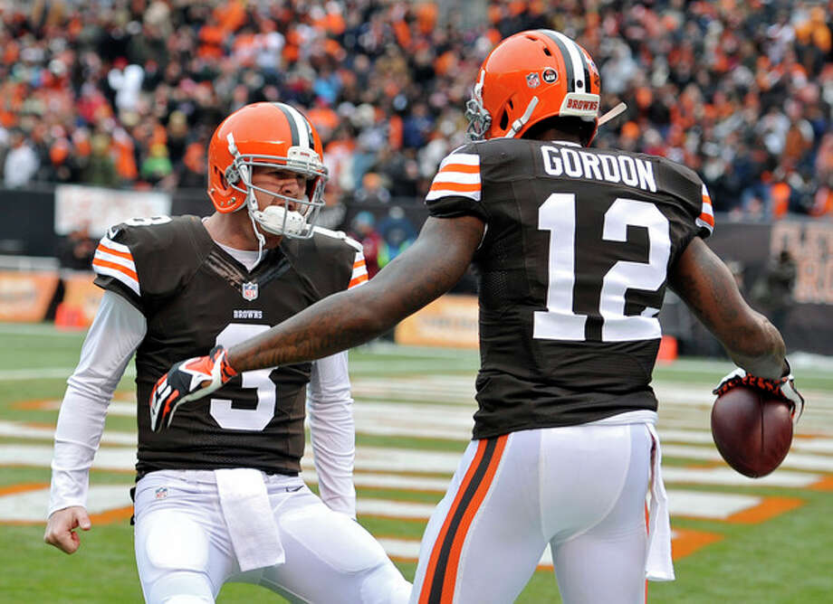 Cleveland Browns quarterback Brandon Weeden (3) celebrates with wide receiver Josh Gordon (12) after they connected on a 21-yard touchdown pass against the Jacksonville Jaguars in the second quarter of an NFL football game on Sunday, Dec. 1, 2013, in Cleveland. (AP Photo/David Richard) / FR25496 AP