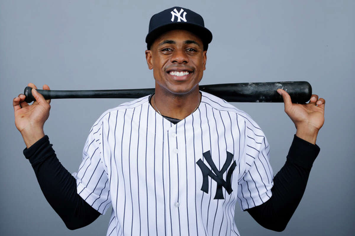 FILE - This is a 2013 photo of Curtis Granderson of the New York Yankees baseball team. A person familiar with the situation says free-agent outfielder Granderson and the New York Mets have agreed to a $60 million, four-year contract. The person spoke to The Associated Press on condition of anonymity Friday, Dec. 6, 2013, because the deal was pending a physical and no announcement had been made. (AP Photo/Matt Slocum, File)