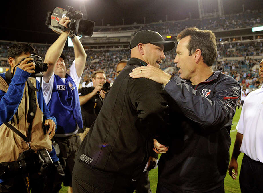 Jacksonville Jaguars head coach Gus Bradley, left, shakes hands with Houston Texans head coach Gary Kubiak, right, after an NFL football game, Thursday, Dec. 5, 2013, in Jacksonville, Fla. Jacksonville beat Houston 27-20. (AP Photo/Stephen Morton) / FR56856 AP