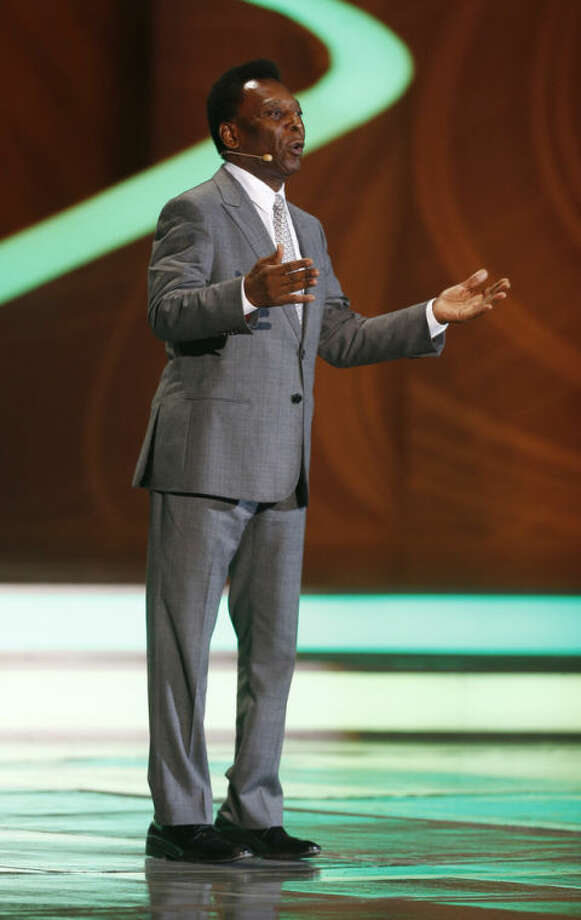 Brazilian soccer legend Pele speaks during the draw ceremony for the 2014 soccer World Cup in Costa do Sauipe near Salvador, Brazil, Friday, Dec. 6, 2013. (AP Photo/Victor R. Caivano)