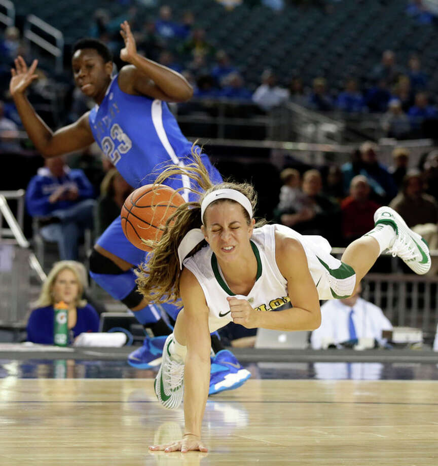 Baylor guard Makenzie Robertson (14) is sent flying after a collision with Kentucky's Samarie Walker (23) in the first half of an NCAA college basketball game, Friday, Dec. 6, 2013, in Arlington, Texas. (AP Photo/Tony Gutierrez) / AP
