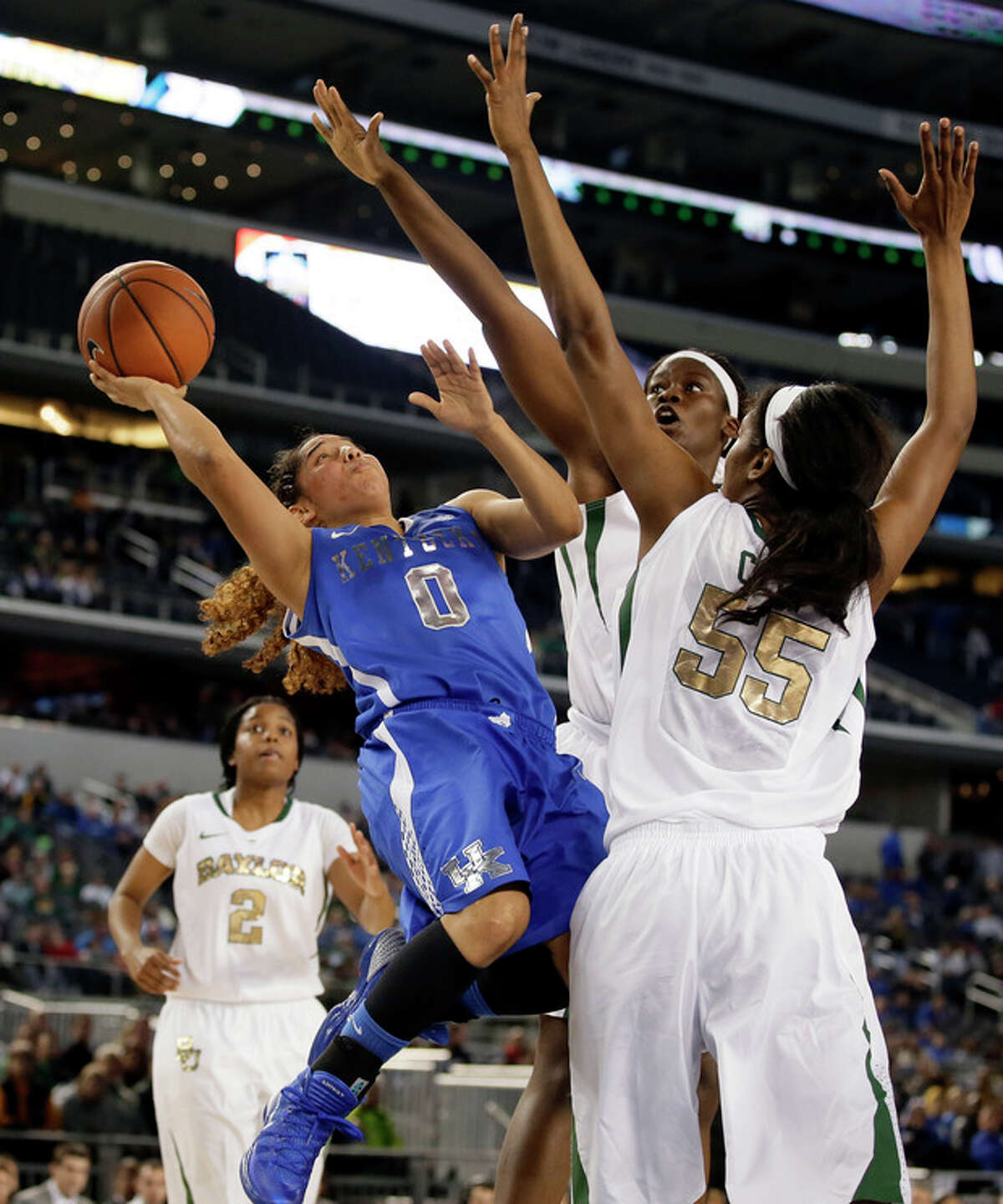 Kentucky's Jennifer O'Neill (0) goes up for a shot-attempt against Baylor's Khadijiah Cave (55) and Sune Agbuke, rear, as Niya Johnson (2) watches in overtime of an NCAA college basketball game, Friday, Dec. 6, 2013, in Arlington, Texas. O'Neill lead her team in scoring with 43-points in the 133-130 four-overtime win over Baylor. (AP Photo/Tony Gutierrez)