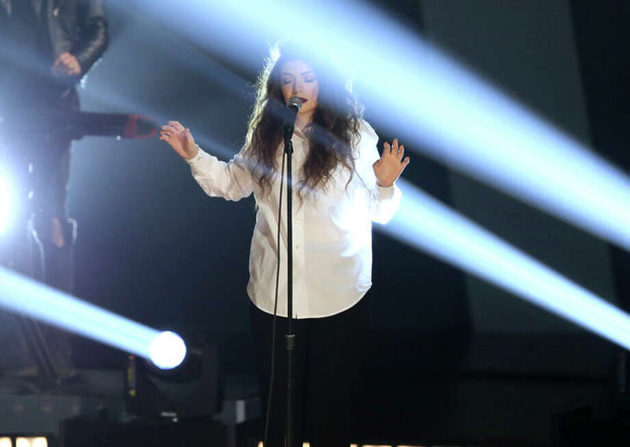 """Lorde performs """"Royals"""" at the Grammy Nominations Concert Live! on Friday, Dec. 6, 2013, at the Nokia Theatre L.A. Live in Los Angeles. (Photo by Matt Sayles/Invision/AP) / Invision"""