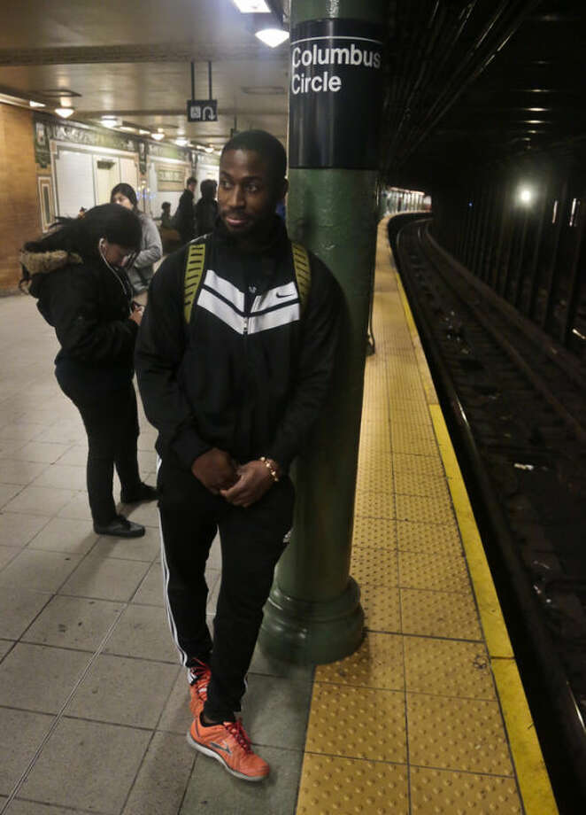 Dennis Codrington, who rescued a man after he onto the subway tracks, stands near the site of the incident on the Columbus Circle subway platform on Thursday, Dec. 5, 2013 in New York. Codrington doesn't know what happened to the man he saved, but he hopes he survived and is healthy. (AP Photo/Bebeto Matthews)