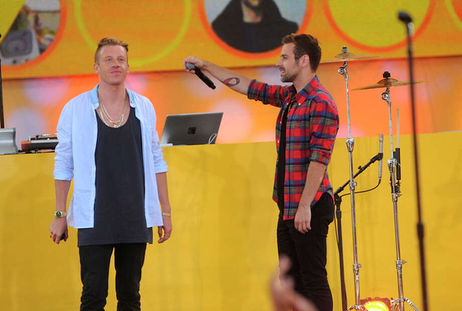 FILE - In this Aug. 16, 2013 file photo, musician Ben Haggerty, also known as Macklemore, left and Ryan Lewis perform on stage at the Good Morning America Concert Series at Central Park's Rumsey Playfield in New York City. Not a lot of fans knew who Macklemore & Ryan Lewis and Lorde were when last we gathered a year ago to celebrate music with the Grammy Awards nominations. Yet thanks to a series of inescapable and smart hits, these upstarts could very well muscle Justin Timberlake, Taylor Swift and other Grammy favorites out of the way when nominees are announced Friday night, Dec. 6, 2013, in a television special broadcast live on CBS. (Photo by Brad Barket/Invision/AP, File) / Invision