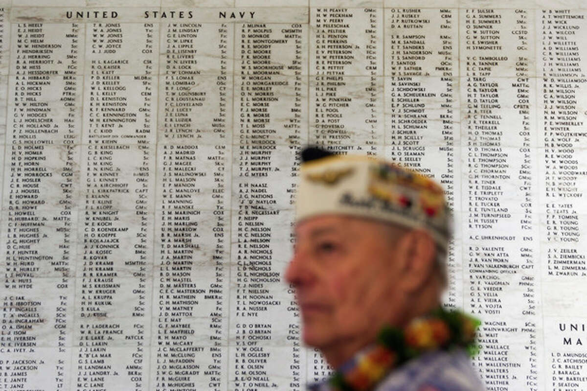Pearl Harbor survivor Lou Contor stands in the memorial room aboard the USS Arizona Memorial during the ceremony commemorating the 72nd anniversary of the attack on Pearl Harbor, Saturday, Dec. 7, 2013, in Honolulu. (AP Photo/Marco Garcia)