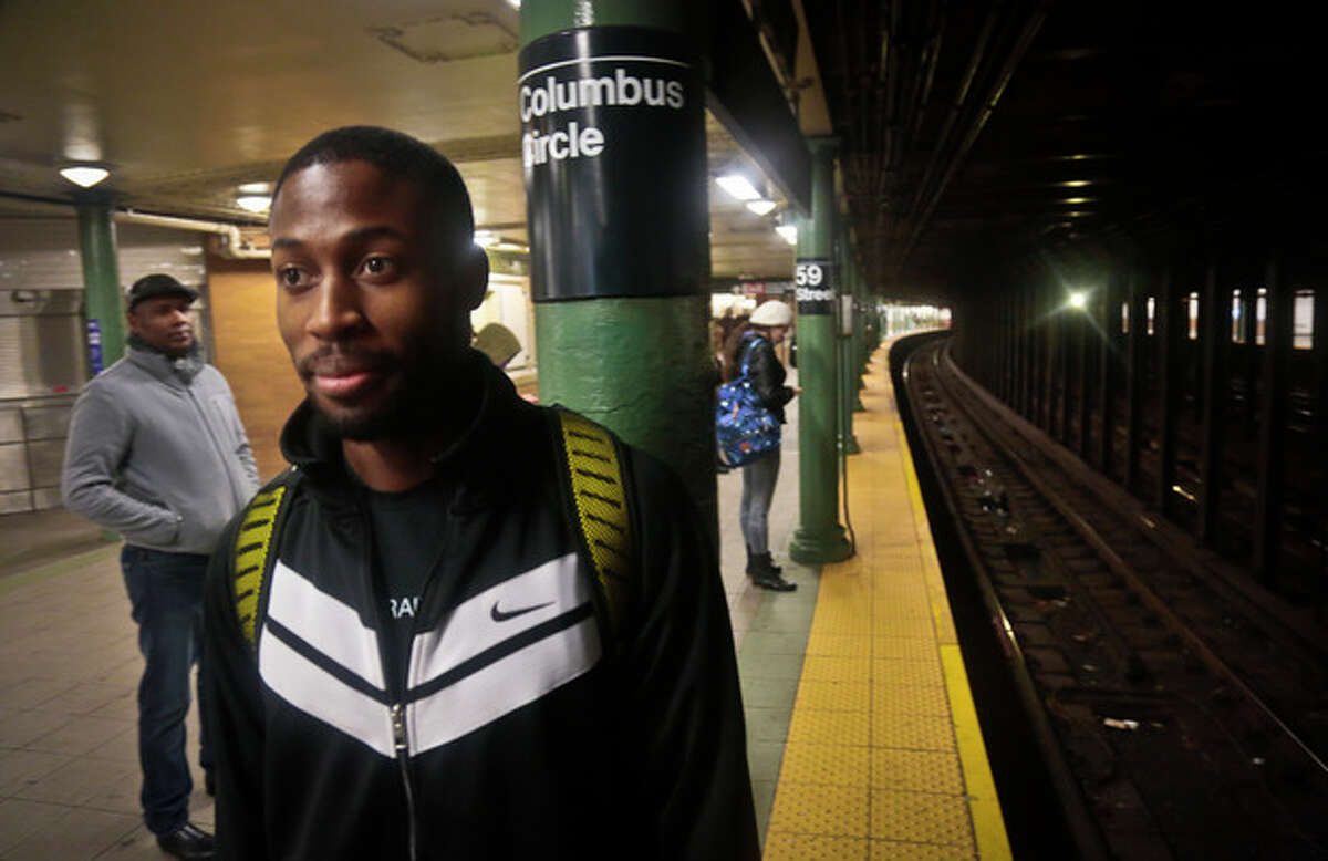 Dennis Codrington, who rescued a man after he onto the subway tracks, stands near the site of the incident on the Columbus Circle subway platform on Thursday, Dec. 5, 2013 in New York. Codrington doesn?'t know what happened to the man he saved, but he hopes he survived and is healthy. (AP Photo/Bebeto Matthews)