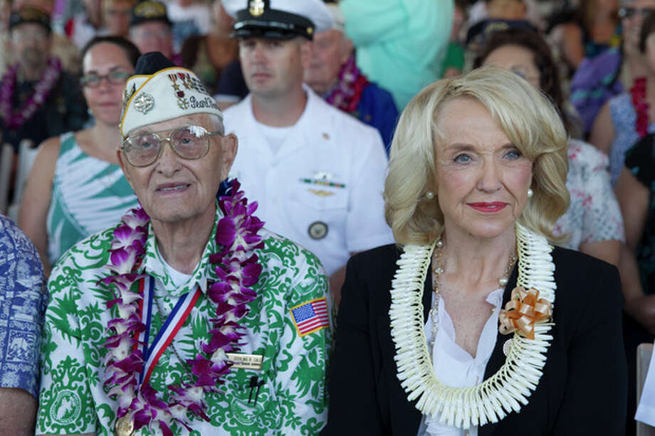Pearl Harbor survivor Sterling Cale, left, and Arizona Gov. Jan Brewer wait for the start of ceremony commemorating the 72nd anniversary of the attack on Pearl Harbor, Saturday, Dec. 7, 2013, in Honolulu. (AP Photo/Marco Garcia) / FR132415 AP