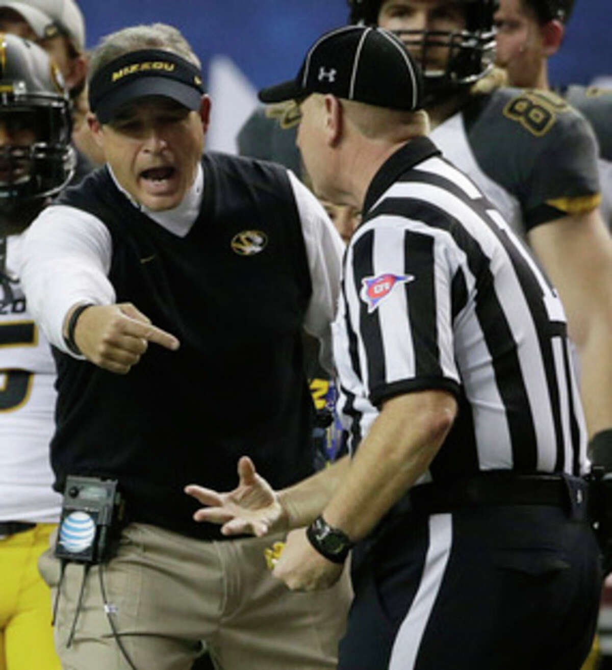 Missouri head coach Gary Pinkel speaks with an official during the second half of the Southeastern Conference NCAA football championship game against Auburn, Saturday, Dec. 7, 2013, in Atlanta. (AP Photo/Dave Martin)