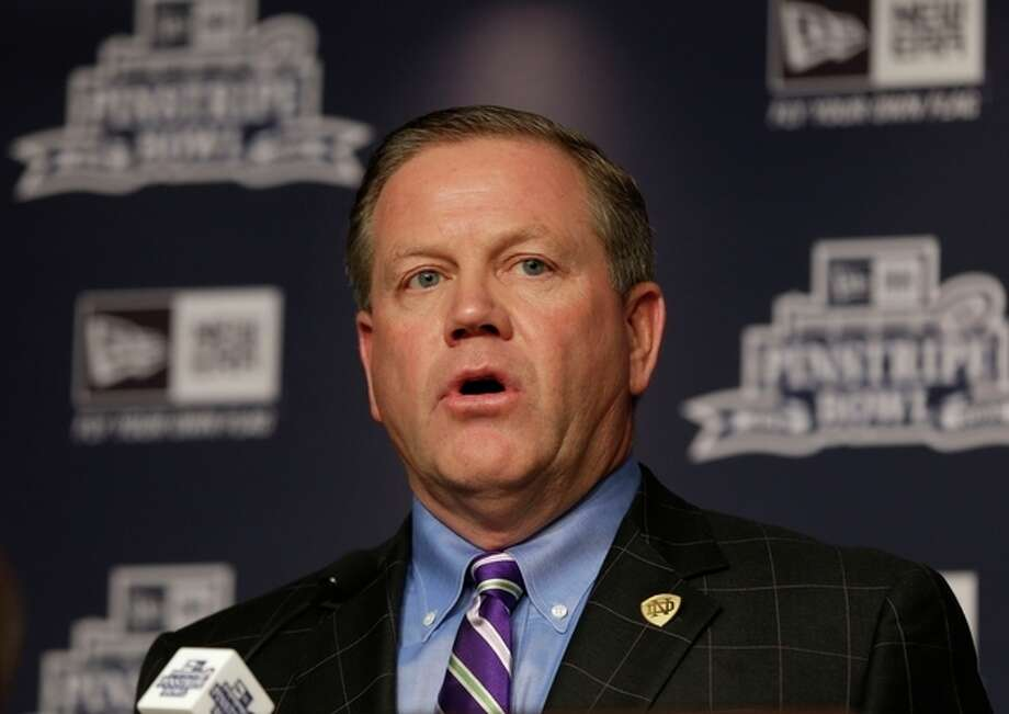 Notre Dame coach Brian Kelly speaks during an NCAA college football news conference in New York, Tuesday, Dec. 10, 2013. Rutgers and Notre Dame will face off at the Pinstripe Bowl at Yankee Stadium on Saturday, Dec. 28, 2013. (AP Photo/Seth Wenig) / AP