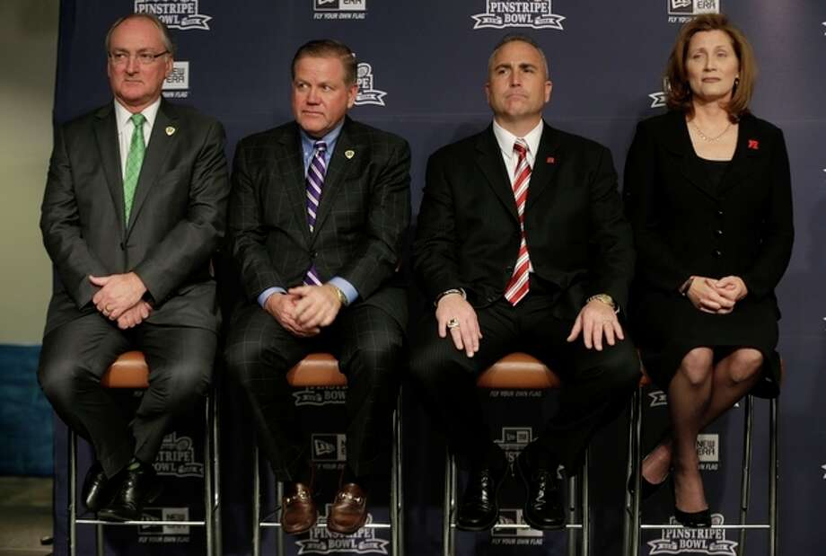 Notre Dame athletic director Jack Swarbrick, left, and head football coach Brian Kelly, second from left, along with Rutgers athletic director Julie Hermann, right, and head football coach Kyle Flood, attend an NCAA college football news conference in New York, Tuesday, Dec. 10, 2013. Rutgers and Notre Dame will face off at the Pinstripe Bowl at Yankee Stadium on Saturday, Dec. 28, 2013. (AP Photo/Seth Wenig) / AP