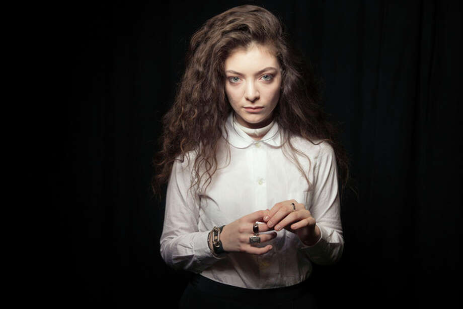 This Nov. 8, 2013 photo shows New Zealand singer Lorde in New York. MTV's college channel has gone in two wildly different directions in naming Pope Francis and pop singer Lorde as its man and woman of the year. MTVU said Tuesday, Dec. 10, that both figures challenged their followers with unexpected stands. (Photo by Victoria Will/Invision/AP) / Invision