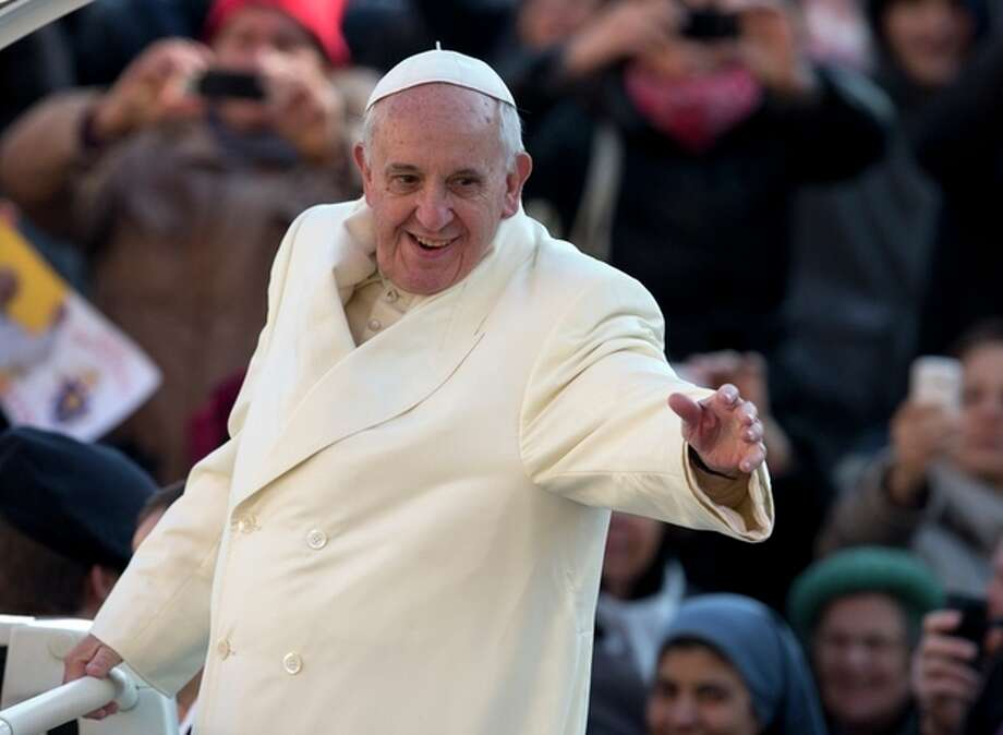 Pope Francis waves as he arrives for his weekly general audience in St. Peter's Square at the Vatican, Wednesday, Dec. 11, 2013. Pope Francis has been selected by Time magazine as the Person of the Year. In only his first year, the Pope was selected by the magazine's editors as the person who had the greatest impact on the world, for good or bad, during 2013. (AP Photo/Alessandra Tarantino) / AP