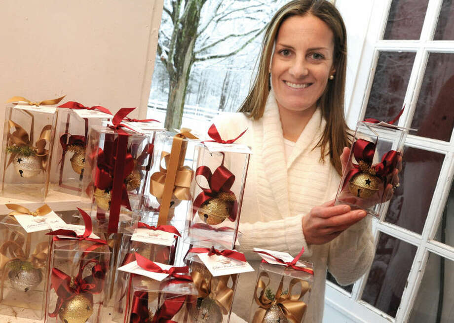 Kate Roomet, president of the Wilton Newcomers Club, which is hosting its annual ornament sale to benefit Wilton Social Services. About 50 working bell ornaments are for sale to assist WSS in purchasing gifts for more than 100 Wilton children this holiday season.
