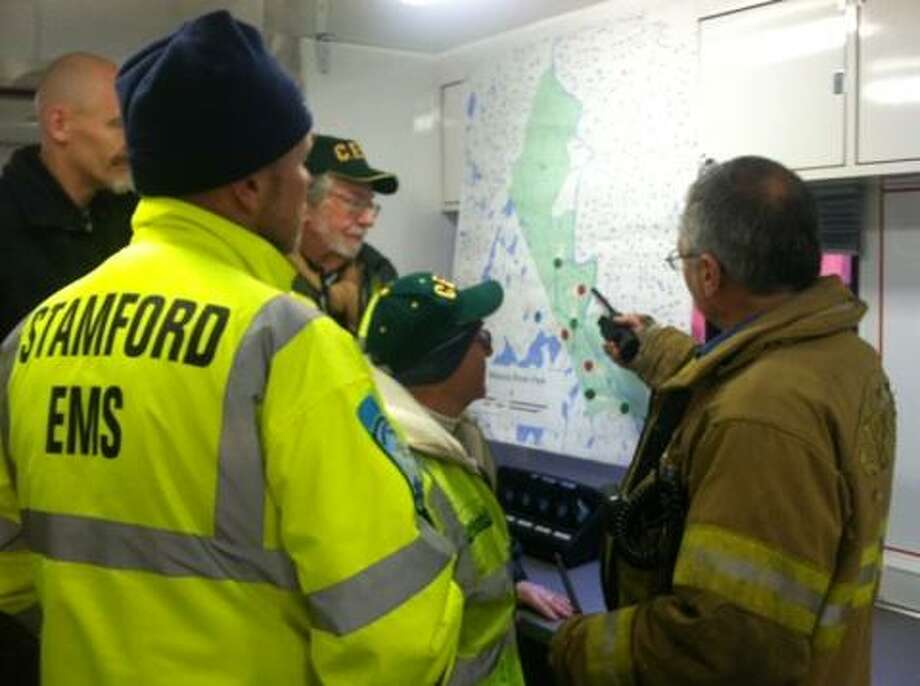Participants in the training exercise are briefed on the search and rescue operation.