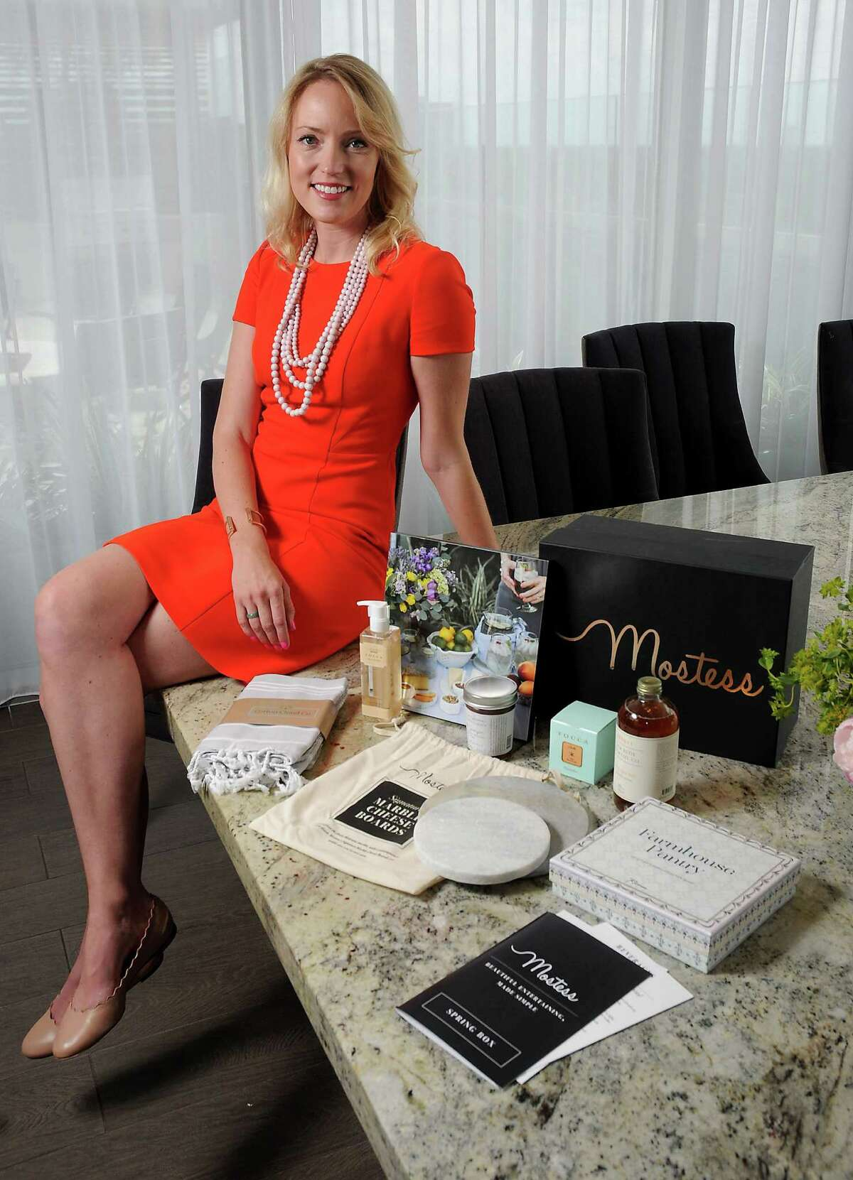 Lindsey Rose King, 32, with her Mostess box, a business she launched earlier this year.