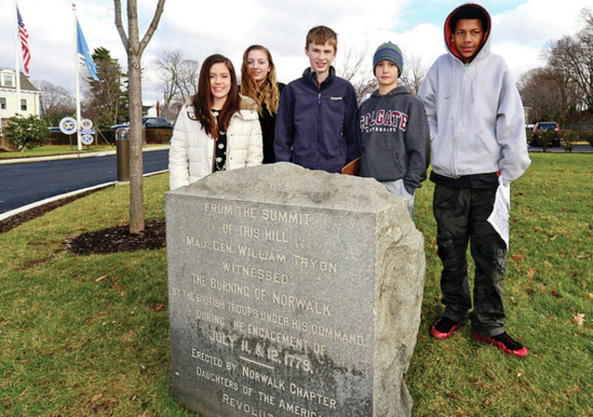 Hour photo / Erik Trautmann Roton Middle School 8th graders Taylor Livingstone, Kathleen Downey, Remy Gibson, Peter Tinnesz and D'Andre Rodriguez participate in a scavenger hunt to learn about Norwalk history Saturday.