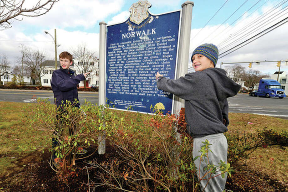 @Hour Blue=[C]Hour photo / Erik TrautmannRoton Middle School eighth graders Remy Gibson and Peter Tinnesz pose for a photo by a plaque along East Avenue with the history of Norwalk as they participate in a scavenger hunt lesson to learn about Norwalk history Saturday. / (C)2013, The Hour Newspapers, all rights reserved