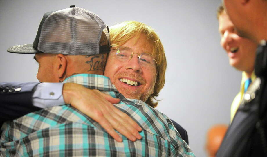 Lead singer of the national rock band, Phish, Trey Anastasio, hugs a graduate of a court drug rehabilitation program in Washington County Court in Ft. Edward, NY, Wednesday, June 15,2016.  Anastasio is a past graduate of the same program. He told five new drug court graduates and a packed courtroom that the program put him on the road to nearly a decade of sobriety and likely saved his life.  (Steve Jacobs/The Post-Star via AP) ORG XMIT: NYGLE101 Photo: Steve Jacobs / The Post-Star