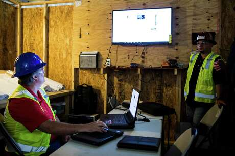 Brian Baker calls up a set of blueprints at a Comfort Systems USA, Inc., job site on Friday, May 13, 2016, in Houston.