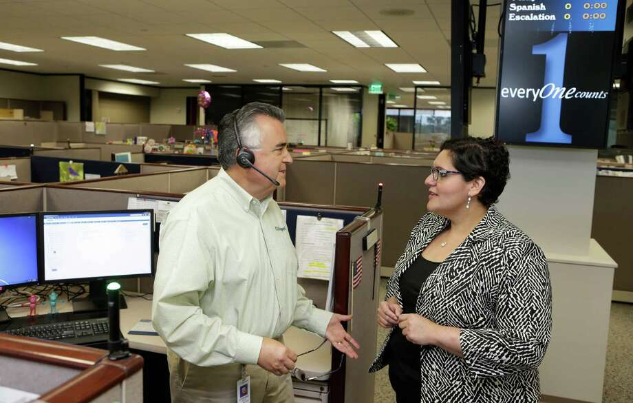 Leonard Perez, left, a senior contact center specialist, and Adelee Mirelez, right, the contact center director, talk at Insperity, 19001 Crescent Springs Dr., Wednesday, May 11, 2016, in Kingwood. Photo: Melissa Phillip, Houston Chronicle / © 2016 Houston Chronicle