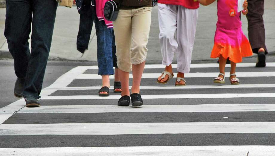 Pedestrians cross Church Street at Broadway in Saratoga Springs. (Times Union staff photo by John Carl D'Annibale) Photo: John Carl D'Annibale / Albany Times Union
