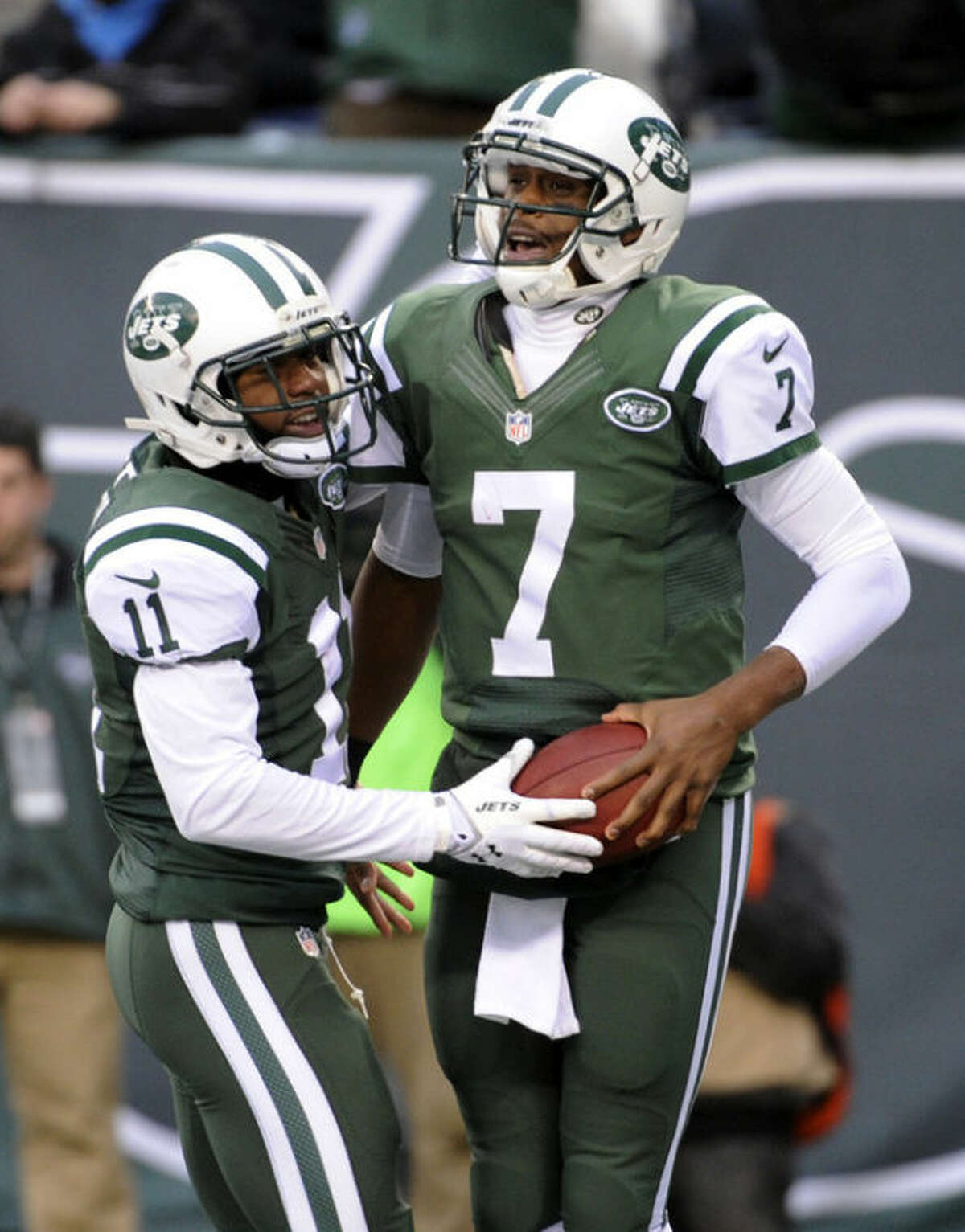 New York Jets quarterback Geno Smith (7) is congratulated by wide receiver Jeremy Kerley (11) after Smith scored on a touchdown run against the Oakland Raiders during the second half of an NFL football game, Sunday, Dec. 8, 2013, in East Rutherford, N.J. (AP Photo/Bill Kostroun)