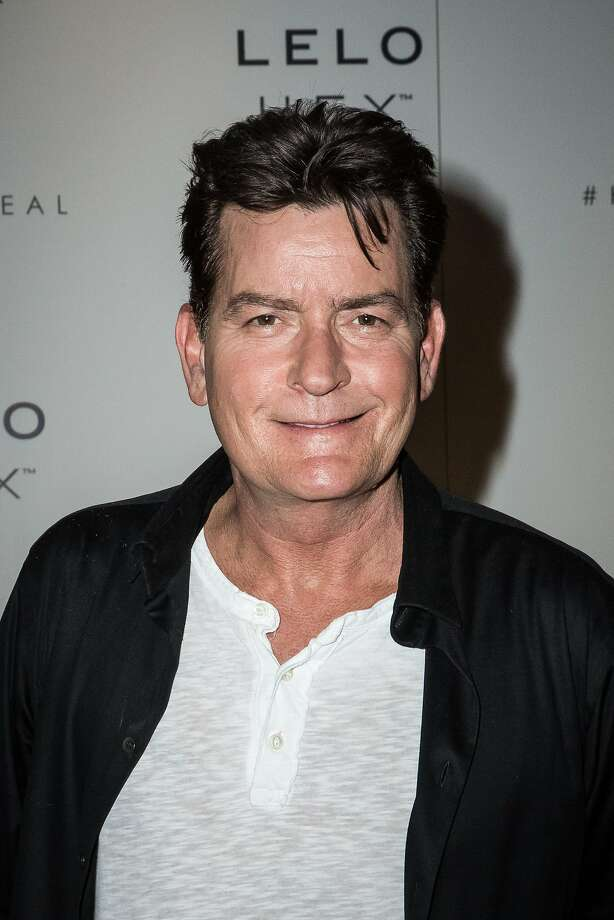 American actor Charlie Sheen, ambassador of the condom brand 'Lelo Hex', poses for photographers after a press conference to celebrate the launch, in London, Thursday June 16, 2016. (Photo by Vianney Le Caer/Invision/AP) Photo: Vianney Le Caer, Associated Press