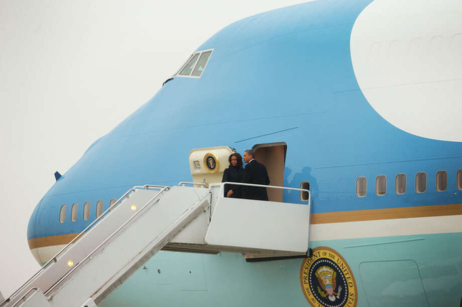 President Barack Obama and first lady Michelle Obama board Air Force One at Andrews Air Force Base, Monday, Dec. 9, 2013. Obama and first lady are traveling to South Africa to attend a tomorrow's memorial service in South Africa honoring Nelson Mandela. (AP Photo/Pablo Martinez Monsivais) / AP