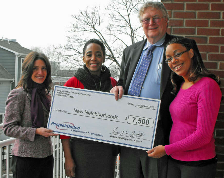 Pictured from left to right: Karen Galbo, marketing, public and community relations director, People's United Community Foundation; Vonda Pommills, Marshall Commons tenant advocate program coordinator; Ross Burkhardt, president & CEO, New Neighborhoods, Inc.; and Yamilette McNeil, Marshall Commons property manager.