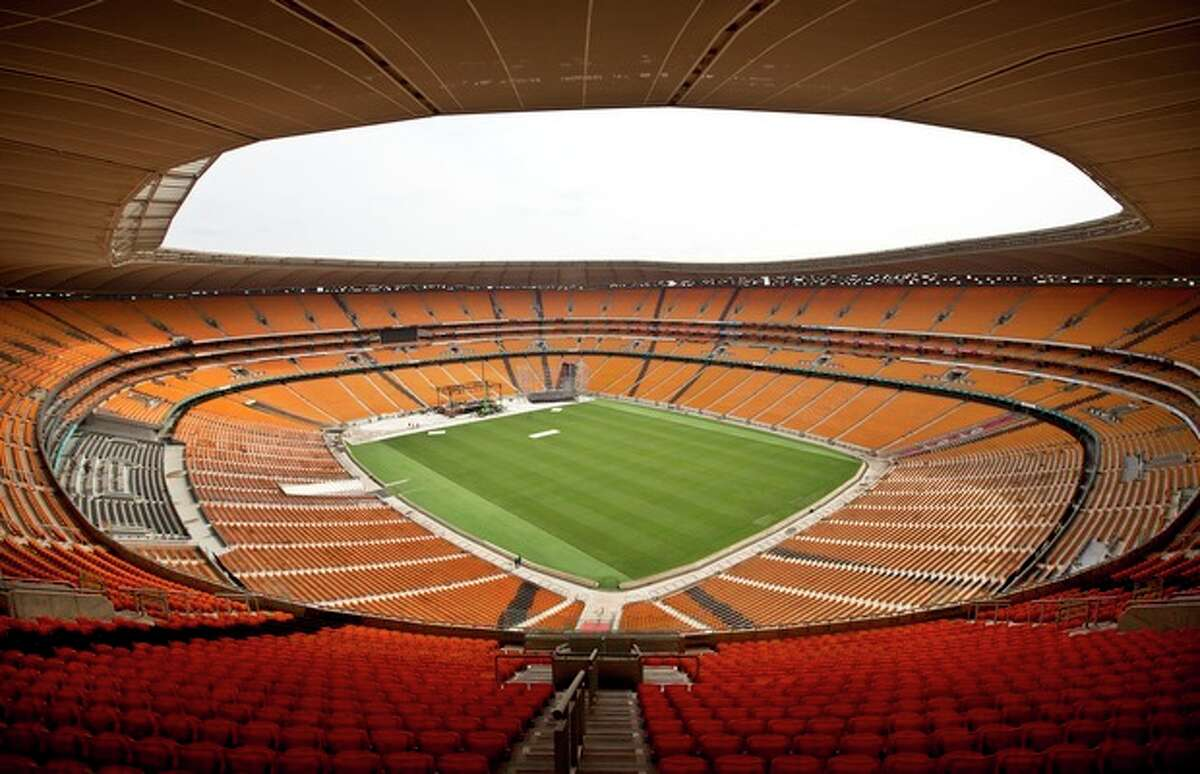 A general view of the FNB stadium where the memorial service for Nelson Mandela will take place on Tuesday, in Johannesburg, South Africa Monday, Dec. 9, 2013. Scores of heads of state and government and other foreign dignitaries, including royalty, are beginning to converge on South Africa as the final preparations for Tuesday's national memorial service for liberation struggle icon Nelson Mandela are put in place. (AP Photo/Ben Curtis)