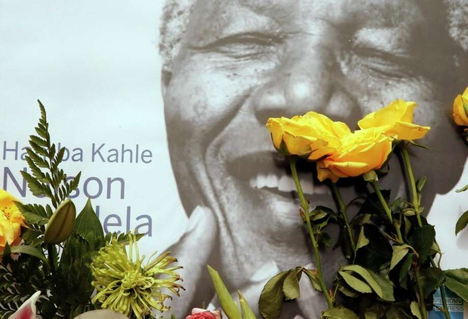A portrait former president Nelson Mandela, placed outside his residence in Johannesburg, South Africa, Monday, Dec. 9, 2013. Mandela died Thursday Dec. 5 at his Johannesburg home after a long illness. He was 95. (AP Photo/Themba Hadebe) / AP
