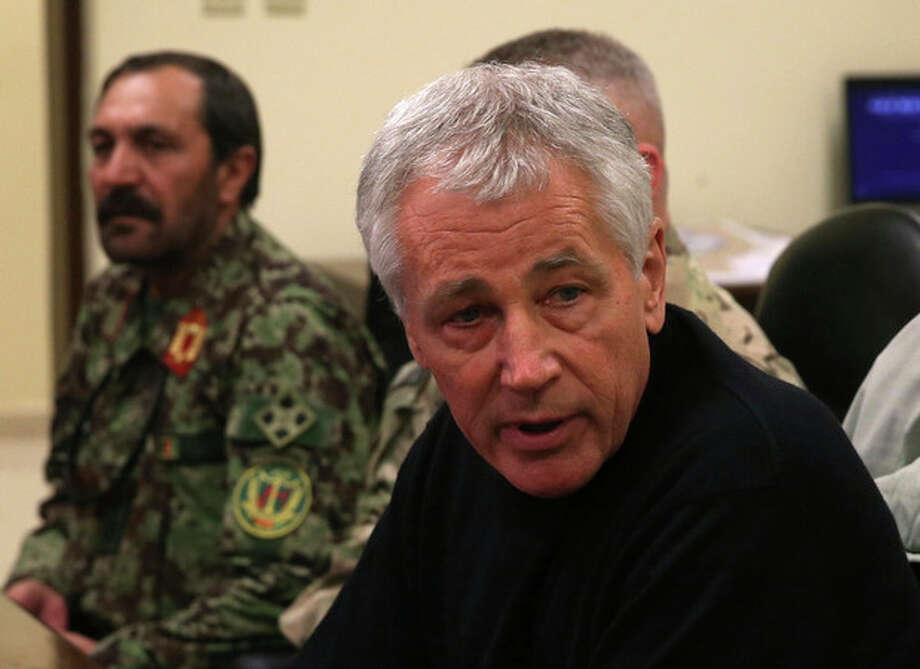 U.S. Secretary of Defense Chuck Hagel, right, speaks during a meeting with Afghan military leaders in Kandahar, Afghanistan, Sunday, Dec. 8, 2013. Hagel spoke with U.S. troops and thanked them for being deployed for the holidays. (AP Photo/Mark Wilson, Pool) / 2013 Getty Images