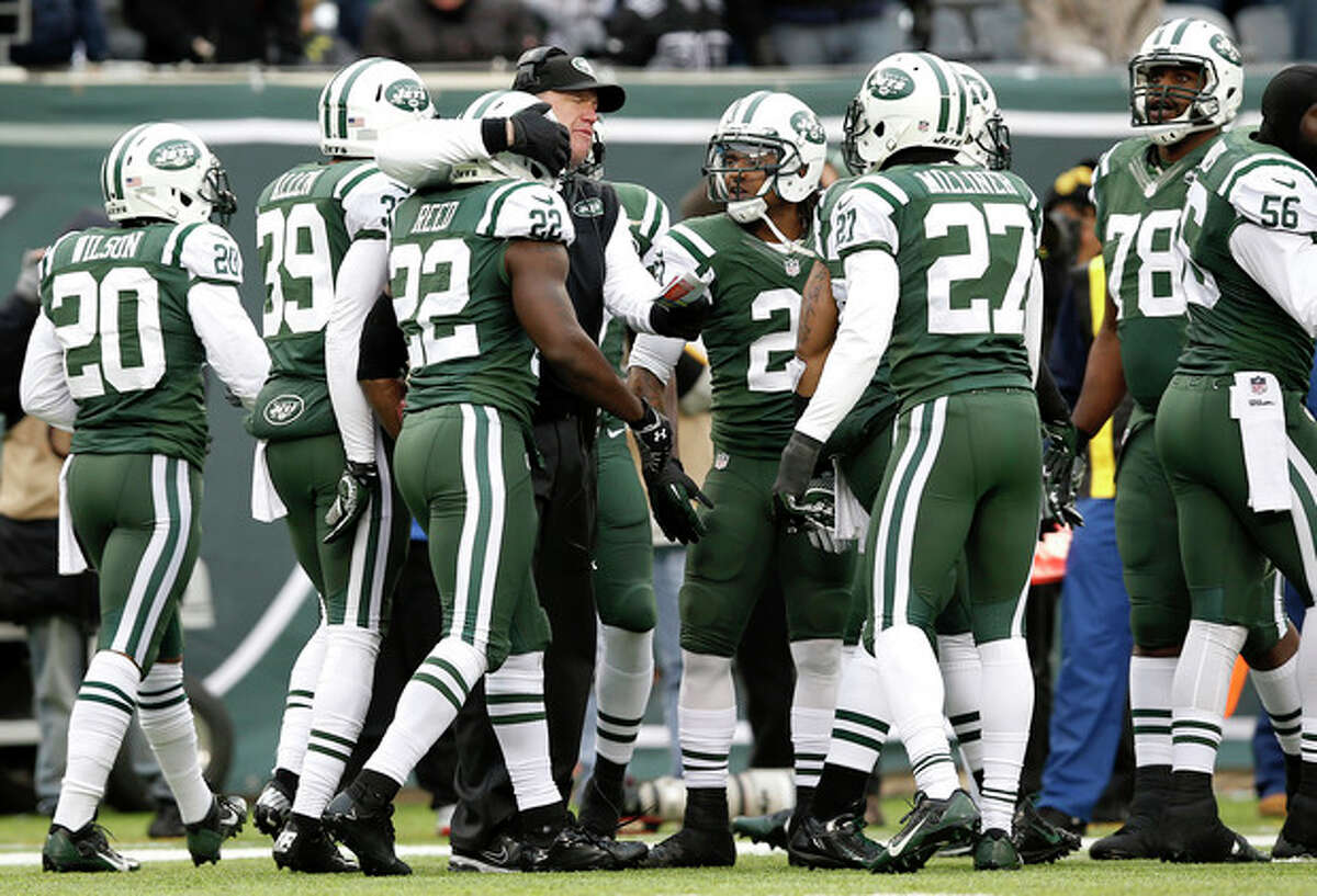 New York Jets head coach Rex Ryan, center left, hugs safety Ed Reed (22) after Reed intercepted a pass from Oakland Raiders quarterback Matt McGloin during the first half of an NFL football game, Sunday, Dec. 8, 2013, in East Rutherford, N.J. (AP Photo/Kathy Willens)