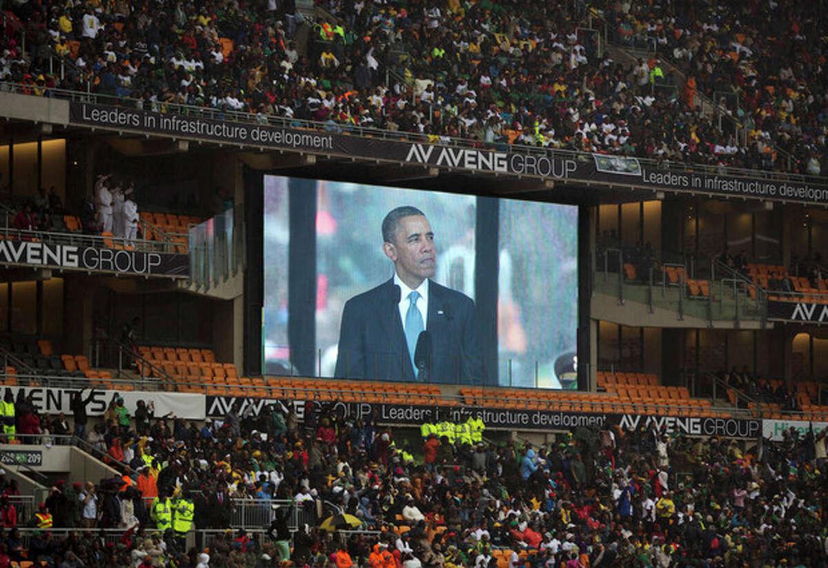 President Barrack Obama speaks to mourners attending the memorial service for former South African president Nelson Mandela at the FNB Stadium in Soweto near Johannesburg, Tuesday, Dec. 10, 2013. (AP Photo/Muhammed Muheisen)